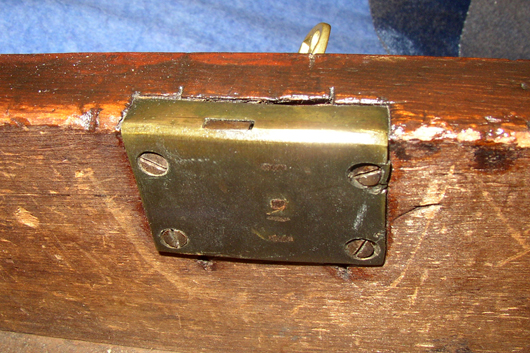 A half mortise lock is implanted part way in the wood but leaves the back  plate - Furniture Specific: $#%& Locks
