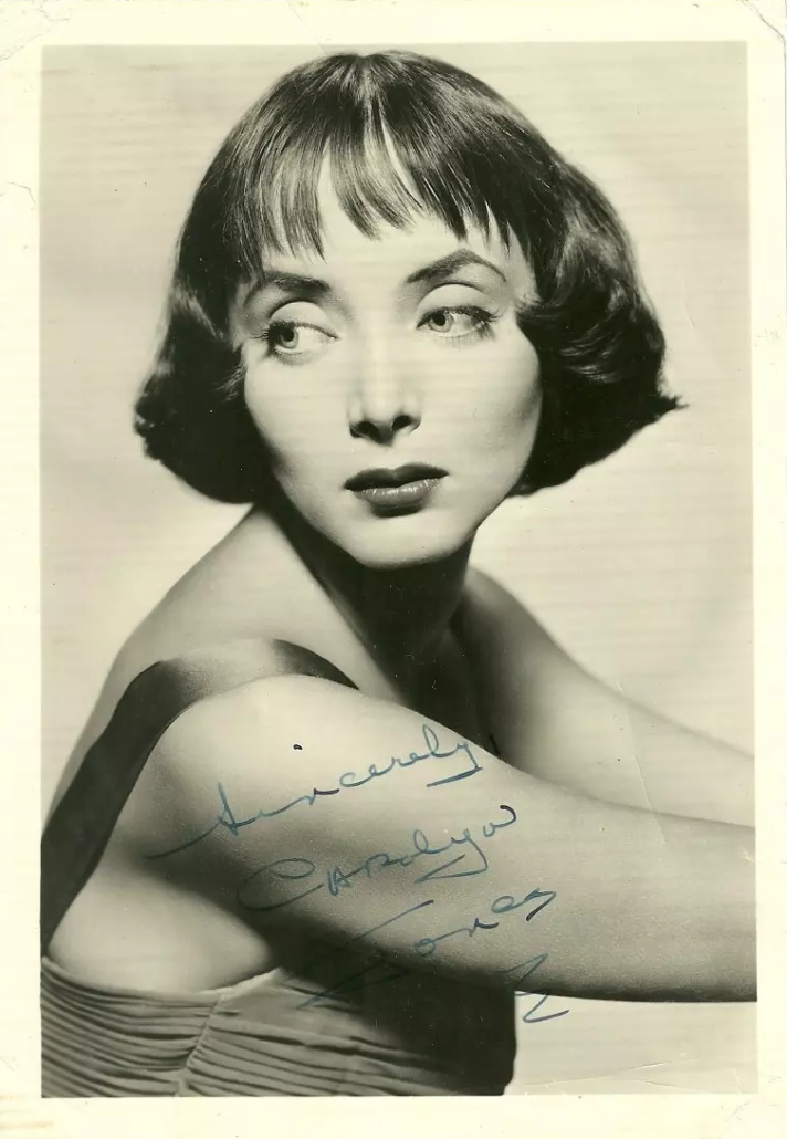 Poster card of Oscar-nominated actress Carolyn Jones, who also received a Golden Globe for her role as Morticia Addams on the TV series The Addams Family, 5 x 7 inches, signed, est. $100-$150
