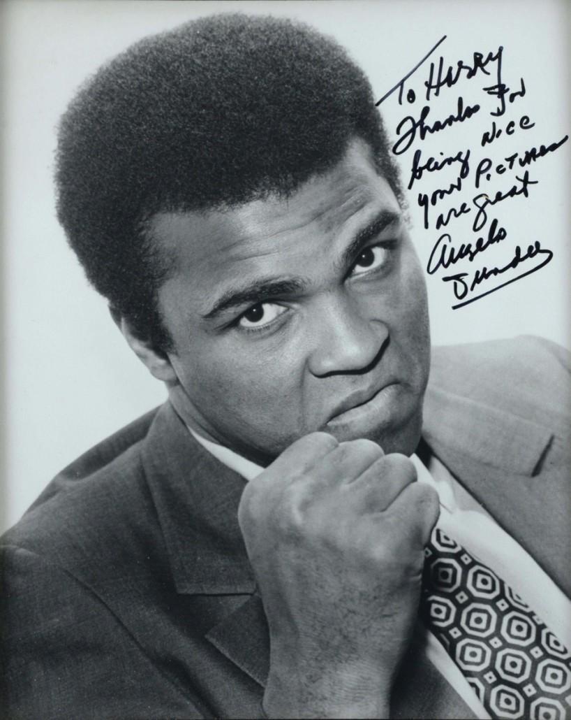 Boxing champion Muhammad Ali by Harry Gooodwin. Photo Ewbank's auctioneers