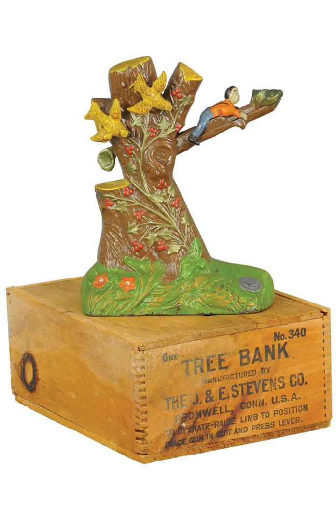 J. & E. Stevens Boy Robbing Bird's Nest mechanical bank with original box, $42,000