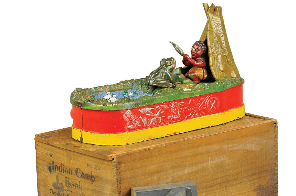 J. & E. Stevens Chief Big Moon (red-base version) mechanical bank with original box, $24,000