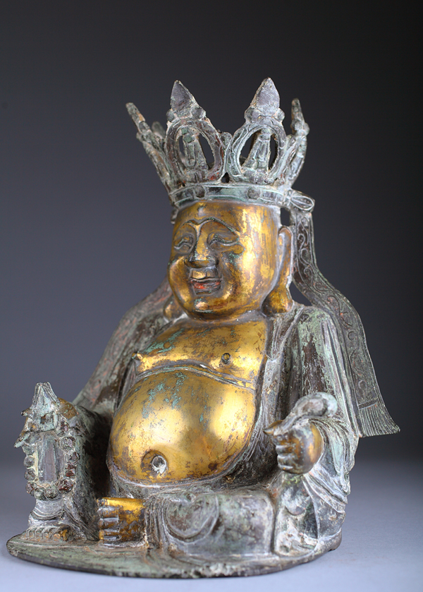 Ming Dynasty gilt bronze Budai, or 'Laughing Buddha,' 12 inches tall, rare form. Provenance: J.S. Rogers, Landover, Md., family collection by descent. Est. $1,200-$1,800