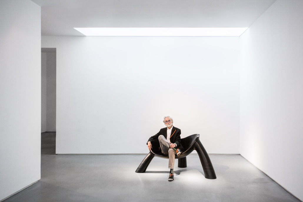 Portrait of Wendell Castle seated on 'Long Night,' 2011. Photo courtesy of Friedman Benda and the artist. Photo by Adrien Millot.
