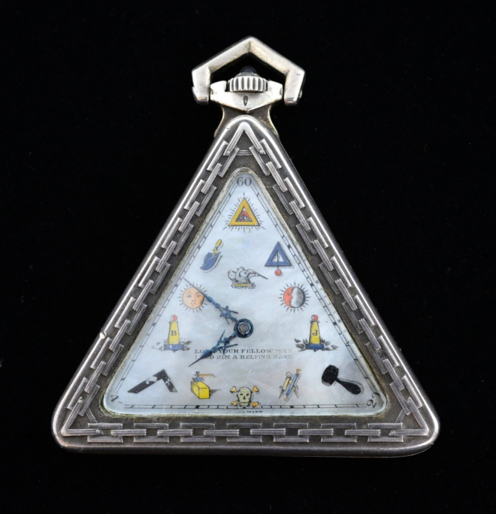 An unusual silver triangular Masonic watch, the mother of pearl dial with Masonic symbols for hours marked 'Love your fellow man lend him a helping hand.' An inscription along the side reads: 'Presented to W Bro H.A Benyon W.M 1941-1942 by the Brethren of the Sirius Lodge 4996 as a token of their esteem & appreciation.' It sold for £700. Photo Ewbank's Auctioneers