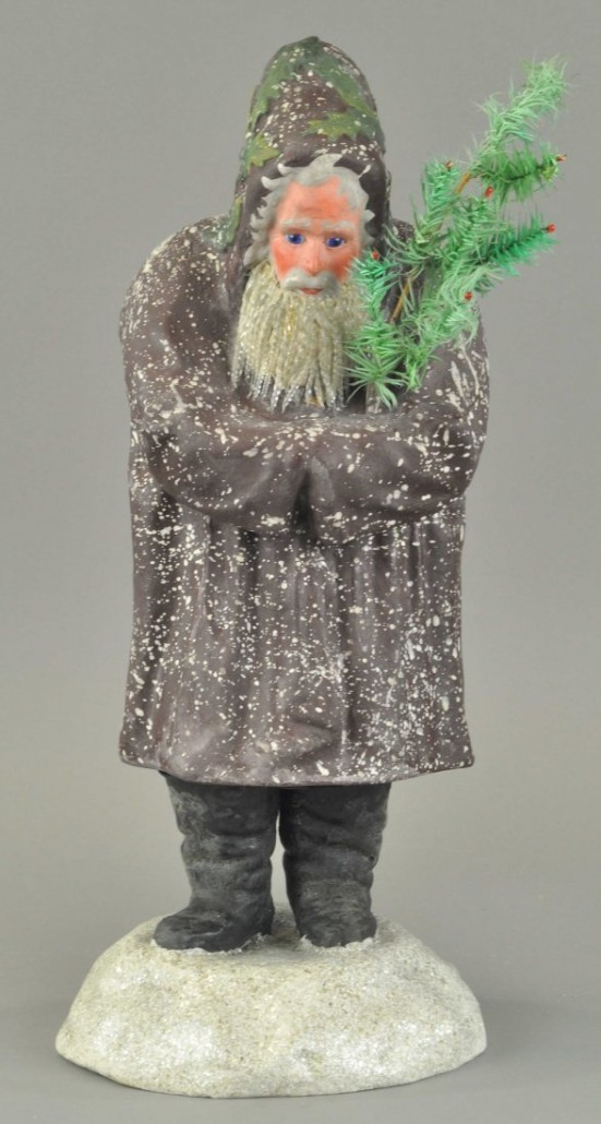 Rare German belsnickle in dark purple robe, with glass icicle beard, holding seven-branch feather tree. Sold for $17,000 by Bertoia Auctions on Nov. 10, 2013. Image courtesy of LiveAuctioneers Archive and Bertoia Auctions