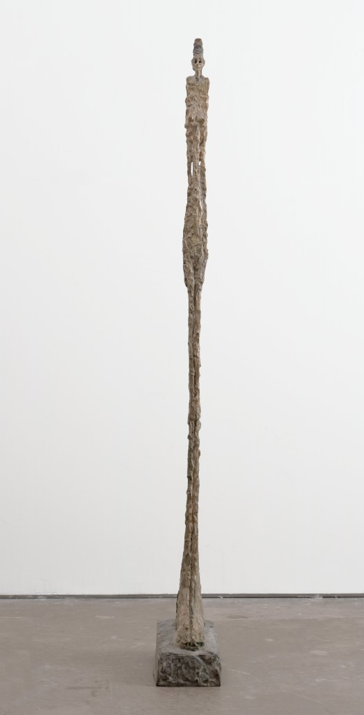 Alberto Giacometti, 'Standing Woman,' 1948 (realizzato nel 1949), bronzo dipinto, 166 x 16.5 x 34.2 cm, The Museum of Modern Art, New York, James Thrall Soby Bequest © 2015 Artists Rights Society (ARS), New York / ADAGP, Paris. In mostra in 'Soldier, Spectre, Shaman: The Figure and the Second World War' al MOMA New York dal 24 ottobre 2015 al 20 marzo 2016