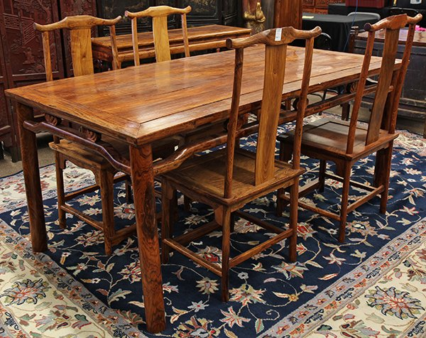 A modern Chinese-style table and four chairs of Vietnamese huanghuali, the humpback stretcher apron accented with ruyi head spacers, sold for a strong hammer price of $150,000 at Clars in 2014. Clars Auction Gallery, Oakland, Calif.