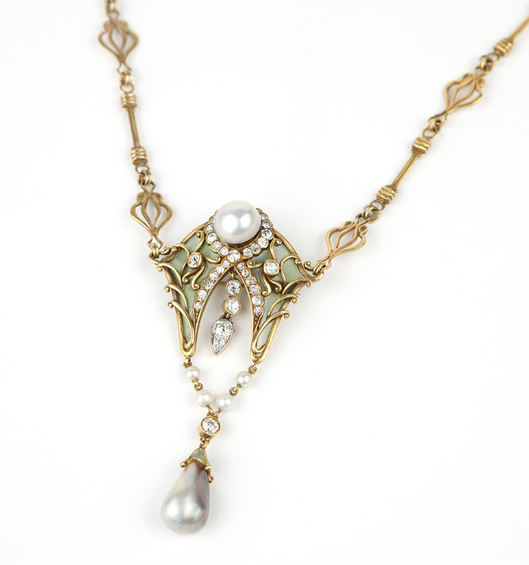 This delicate antique diamond, gold and plique-à-jour necklace was extremely popular with phone buyers; the necklace brought an astounding $28,800 at the December 8th event (est. $4,000/6,000).