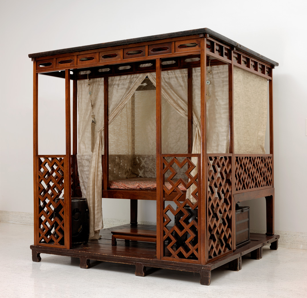 This 16th century huanghuali canopy bed with silk gauze is actually an intimate room setting. Within the enclosure, the occupant could entertain friends with tea or issue orders to servants before arising for the day. Courtesy Nelson-Atkins Museum of Art, Kansas City, Missouri