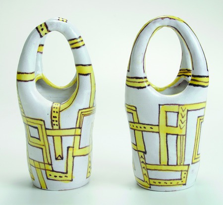A pair of Guido Gambone vases with high looped handles and a yellow and purple geometric design sold at auction in 2015 for $4,012.