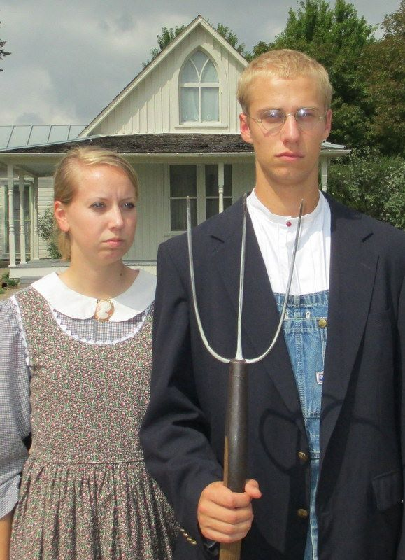 A Couple Dressed Up To Duplicate The Painting At American Gothic House