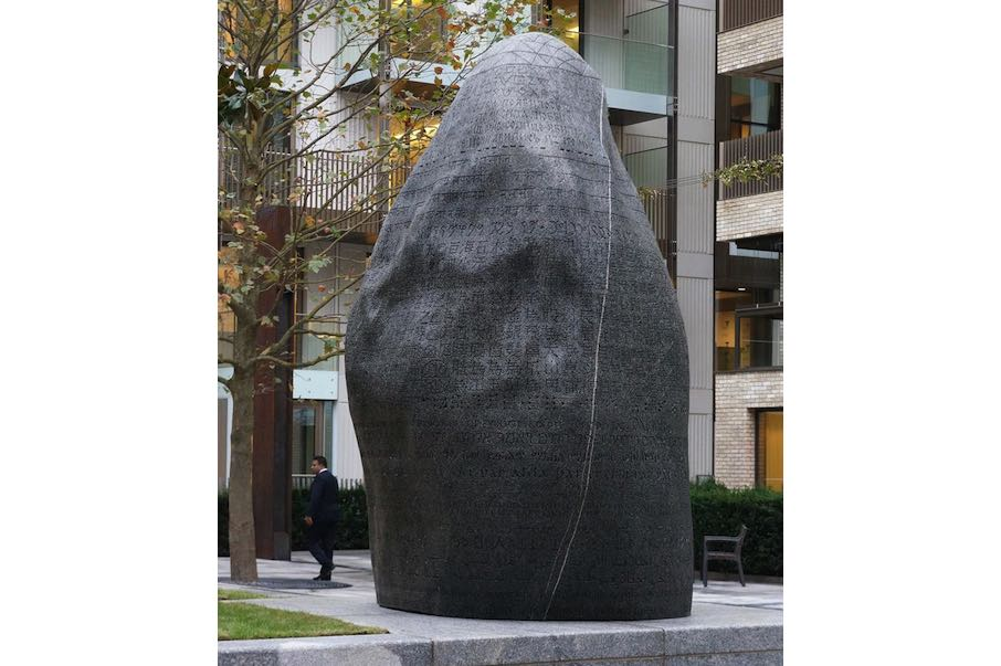 'The One and the Many,' a 24-ton granite boulder inscribed with ancient scripts from the world's cultures, by Peter Randall-Page installed at Fitzroy Place, London. Image by Thomas Randall-Page, courtesy Peter Randall-Page, Exemplar and Aviva Investors