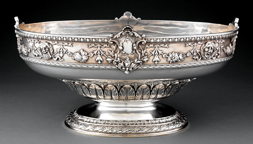 Wine cisterns were heavy silver vessels, sometimes quite large, used for cooling bottles, which became popular in the late 17th century. This Gorham example with Comedy and Tragedy masks, circa 1880, weighs 162.25 troy ounces and brought $23,900 at Neal's in 2012. Courtesy Neal Auction Co.